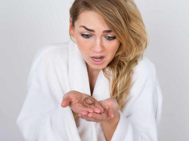 Przyczyny wypadania włosów po porodzie